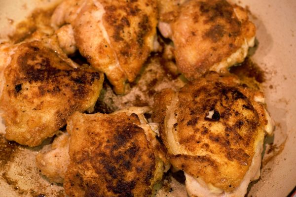 Browned chicken thighs with beautifully crisp skin.