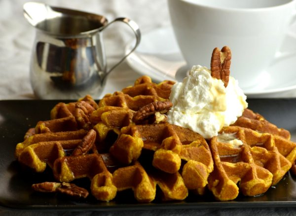 Pumpkin Waffles with warm Maple syrup and pecans