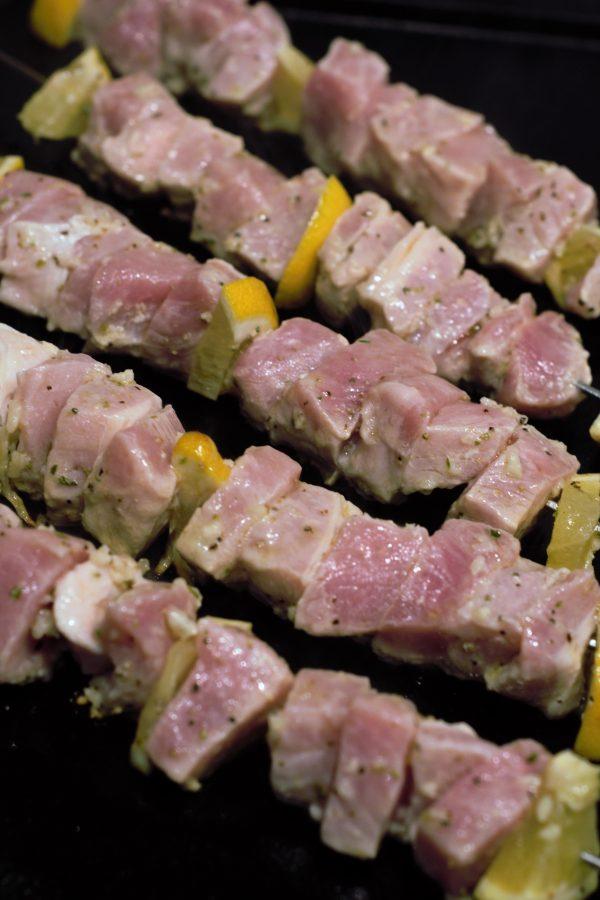 Cubed mariniated pork souvlaki on the grill.
