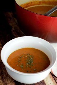 Bowl of tomato basil bisque soup.