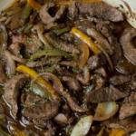 pepper steak close up in red pan